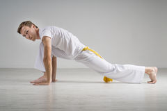 Young man doing stretching exercises Royalty Free Stock Photography