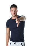 Young man doing thumb down sign Stock Photo