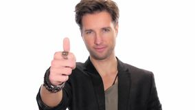 Young man doing thumb-up sign over white background stock video