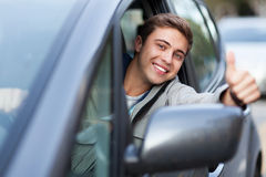 Young man doing thumps-up in car Royalty Free Stock Photography