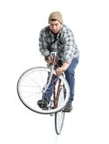 Young man doing tricks on a bicycle on a white Royalty Free Stock Photos