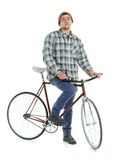 Young man doing tricks on fixed gear bicycle on a white Royalty Free Stock Image