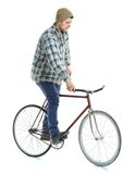 Young man doing tricks on fixed gear bicycle on a white. Background stock image