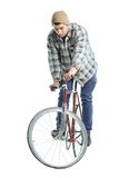 Young man doing tricks on fixed gear bicycle on a white Stock Photography