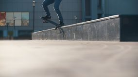 Young man doing a tricks with skateboard in the city street. Slow motion stock video footage
