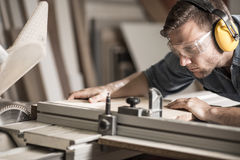 Young man doing woodwork Stock Image