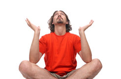 Young man doing yoga exercise Stock Photos