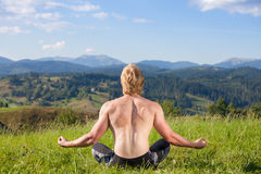 Young man doing yoga exercise Royalty Free Stock Photography