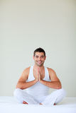 Young man doing yoga in his bedroom Royalty Free Stock Photos