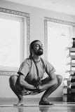 Young man doing yoga  indoor Royalty Free Stock Images