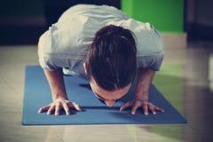 Young man doing yoga  indoor Royalty Free Stock Photos