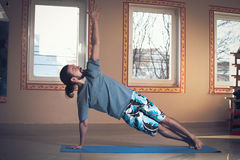 Young man doing yoga  indoor Royalty Free Stock Image