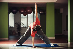 Young man doing yoga indoor Royalty Free Stock Photography