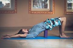 Young man doing yoga  indoor Stock Photo