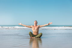 Young man doing yoga meditation Stock Images