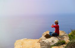 Young man doing yoga in mountains Royalty Free Stock Images