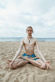 Young man doing yoga Royalty Free Stock Photos