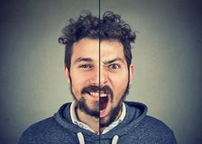 Young man with double face expression. Bipolar disorder concept. Young man with double face expression  on gray background Stock Image