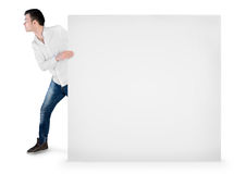 Young man drag empty board Royalty Free Stock Photo