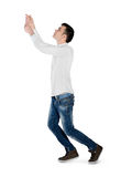 Young man drag something. Isolated young man drag something Royalty Free Stock Image