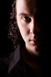 Young man dramatic light portrait Royalty Free Stock Photos