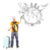 Young man drawing global map and famous landmark. Over white background royalty free stock photography