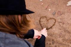 Young man drawing heart Stock Photos