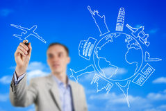 Young man drawing an imaginary airplane flying royalty free stock photo