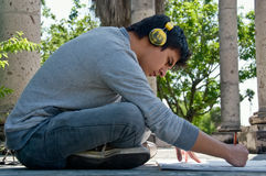 Young man drawing outdoor Royalty Free Stock Images