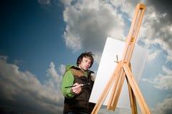Young man drawing outdoors Stock Photos