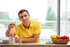 The young man drawing pictures in studio Stock Photo