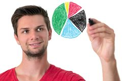 Young man drawing a pie chart Stock Image