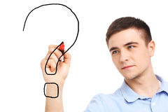 Young Man drawing question mark Royalty Free Stock Image
