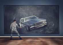 Young man draws with chalk stock image