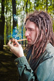 Young man with dreadlock hair. Royalty Free Stock Photo