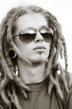 Young man with dreadlocks Royalty Free Stock Image