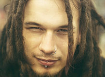 Young man with dreadlocks Royalty Free Stock Photography