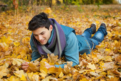 Young man dreaming in park. Stock Photography