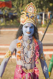 A young man dressed as Lord Krishna Royalty Free Stock Image