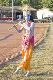 A young man dressed as Lord Krishna Royalty Free Stock Photography