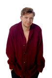 Young man dressed in a maroon sweater Royalty Free Stock Photography