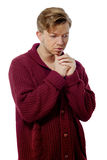 Young man dressed in a maroon sweater Stock Photo