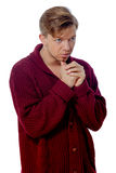 Young man dressed in a maroon sweater Stock Image