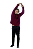 Young man dressed in a maroon sweater Royalty Free Stock Photo