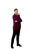 Young man dressed in a maroon sweater Royalty Free Stock Images