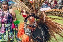 A Young man dressed in Native American regalia at Pow Wow, Malibu, CA. A Young Man is one of many Native American who is participating at a Pow Wow. 2019 21st royalty free stock images