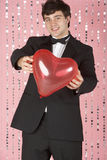 Young Man Dressed In Suit Holding Heart Royalty Free Stock Photos