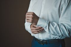 The young man dresses cuff links on a shirt 2291. Royalty Free Stock Photo