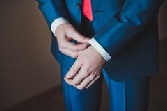 The young man dresses cuff links on a shirt 2292. Royalty Free Stock Images