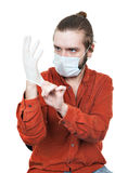 The young man dressing a medical rubber glove Stock Images
